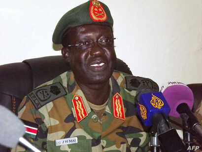 FILE - The Sudan People's Liberation Army (SPLA) Chief of Staff General James Hoth Mai speaks to the media in Juba, Jan. 2, 2014.