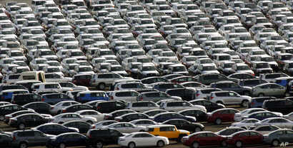 FILE - Autos line the dock after coming off a ship from Japan at the Port of Portland, in Portland, Oregon, June 6, 2006.