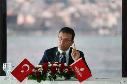 FILE - Ekrem Imamoglu, the new Mayor of Istanbul from Turkey's main opposition Republican People's Party (CHP), talks to members of foreign media in Istanbul, June 28, 2019.