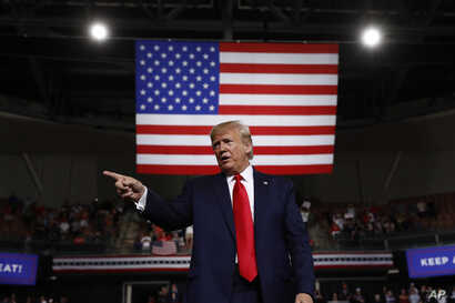 FILE - President Donald Trump reacts at the end of his speech at a campaign rally in Manchester, N.H., Aug. 15, 2019.