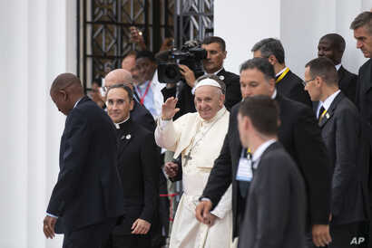 Pope Francis waves to wellwishers as he leaves after a meeting at the Cathedral of the Immaculate Conception in the capital Maputo, Mozambique Thursday, Sept. 5, 2019.
