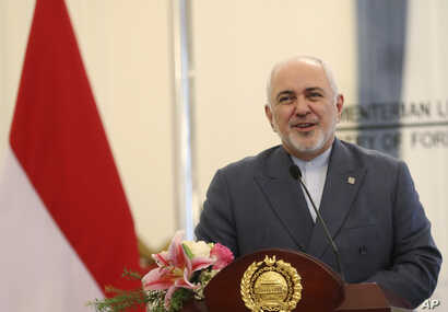 Iran's Foreign Minister Mohammad Javad Zarif talks to journalists during a joint press conference