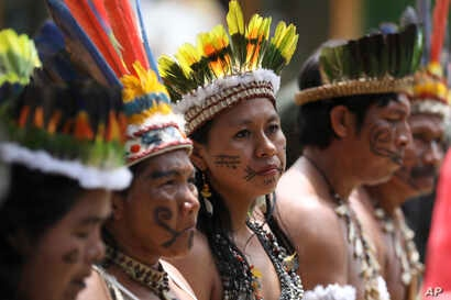 Representatives of the Huitoto and Ticuna indigenous communities wait whileleaders of several South American nations that share the Amazon are meeting, in Leticia, Colombia, Sept. 6, 2019.
