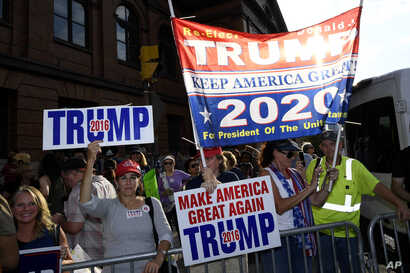 Supporters of President Donald Trump gather near the U.S. House Republican Member Retreat in Baltimore, Sept. 12, 2019.