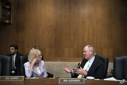 Senate Committee on Health, Education Labor and Pensions ranking member Patty Murray of Wash., and Chairman Lamar Alexander of Tenn., talk after the nomination hearing for Eugene Scalia as Secretary of Labor on Capitol Hill, Sept. 19, 2019.