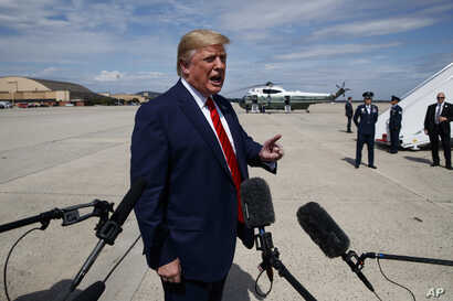 President Donald Trump talks with reporters after arriving at Joint Base Andrews, Sept. 26, 2019, in Maryland.