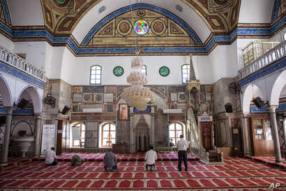 Israeli Arabs pray at the El-Jazzar Mosque in the old city of Acre, northern Israel, Sept. 24, 2019.