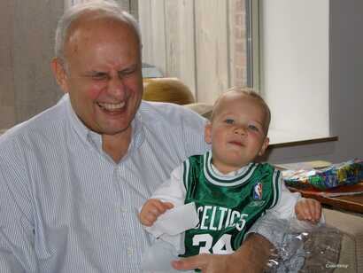 Leslie Gelb, in a photo taken in 2006, was seen laughing with Patrick, one of his five grandsons. (Photo courtesy of Leslie Gelb family)