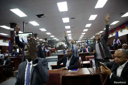 Haitian deputies ask for the floor after the speech of appointed Prime Minister Fritz William Michel to present his plan