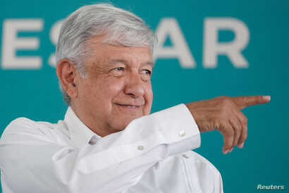 FILE - Mexico's President Andres Manuel Lopez Obrador gestures during an official event in Sabinas, in Coahuila state, Mexico, May 4, 2019.