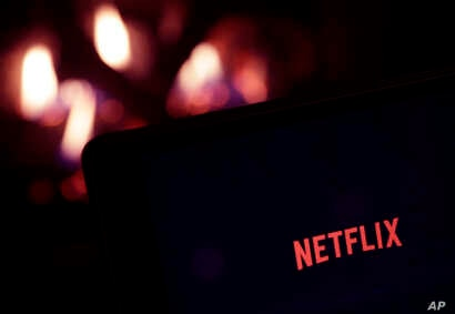 FILE - The Netflix logo is seen on a tablet, in North Andover, Massachusetts, Jan. 17, 2017.