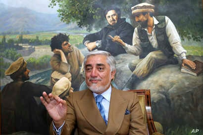 Abdullah Abdullah, a key candidate in Afghanistan's upcoming presidential election, speaks during an interview at his home, in Kabul, Afghanistan, Sept. 26, 2019.