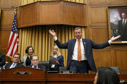 Rep. Doug Collins, R-Ga., the ranking member on the House Judiciary Committee, right, throws his arms up in the air in frustration after a one-minute recess is called shortly before the hearing in the questioning of Corey Lewandowski ends, Sept. 17, 2019.