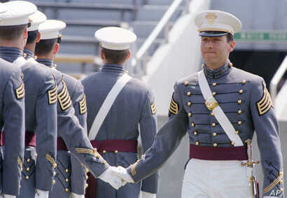 FILE - Mike Pompeo, top graduate of the 1986 class at the U.S. Military Academy at West Point, New York, is congratulated by fellow cadets during graduation ceremonies, May 29, 1986.