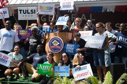 Supporters of several of the Democratic presidential candidates gather for a photo ahead of the Galivants Ferry Stump, Sept. 16, 2019, in Galivants Ferry, South Carolina.
