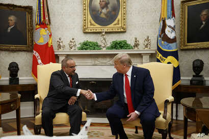 President Donald Trump shakes hands with Bahrain's Crown Prince Salman bin Hamad Al Khalifa during a meeting in the Oval Office of the White House, Monday, Sept. 16, 2019, in Washington.