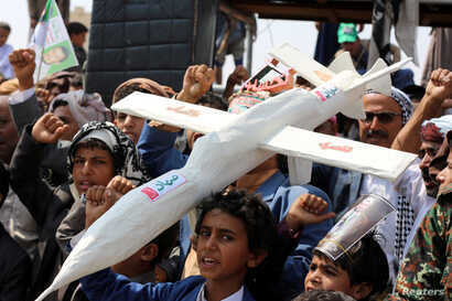 FILE - Houthi rebel supporters carry a mock drone during a rally in Saada, Yemen, Sept. 10, 2019.