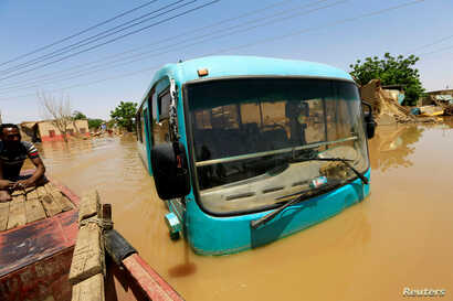 A bus is seen partially submerged in flood waters near the River Nile, on the outskirts of Khartoum, Sudan, Sept. 2, 2019.
