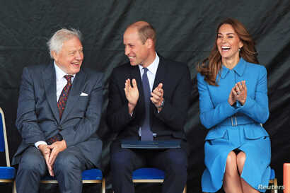 Britain's Prince William and Catherine, Duchess of Cambridge, and Sir David Attenborough react during the naming ceremony for the new polar research ship RRS Sir David Attenborough at Cammell Laird shipyard in Birkenhead, Sept. 26, 2019