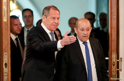 Russian Foreign Minister Sergei Lavrov and his French counterpart Jean-Yves Le Drian arrive for a meeting of the Russian-French Security Cooperation Council in Moscow, Russia, Sept. 9, 2019.