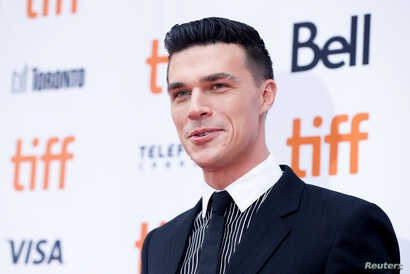 "Actor Finn Wittrock poses as he arrives at the Canadian premiere of ""Judy"" at the Toronto International Film Festival (TIFF) in Toronto, Ontario, Canada, Sept. 10, 2019."