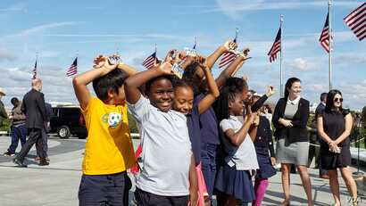 "Fourth graders from Amidon Bowen elementary school in Washington DC with their ""Every Kid in the Outdoors"" that gives them free access to national parks, Sept. 19, 2019. (P. Widakuswara)"
