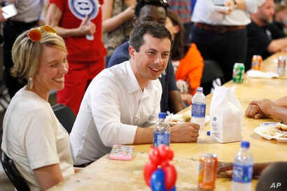 Democratic presidential candidate Pete Buttigieg speaks with local residents at the Hawkeye Area Labor Council Labor Day Picnic…
