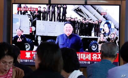 People watch a TV showing a file image of North Korean leader Kim Jong Un during a news program at the Seoul Railway Station in Seoul, South Korea, Oct. 2, 2019.