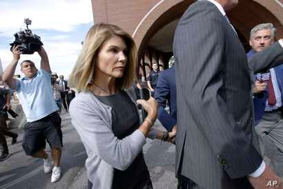 FILE - In this Aug. 27, 2019 file photo, actress Lori Loughlin departs federal court in Boston after a hearing in a nationwide…