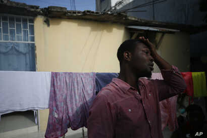 Entrepreneur and youth leader Pascéus Juvensky St. Fleur, 26, walks in the courtyard of his family's home in the Delmas…