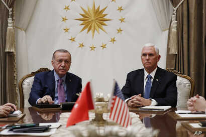 Vice President Mike Pence meets with Turkish President Recep Tayyip Erdogan at the Presidential Palace for talks on the Kurds…
