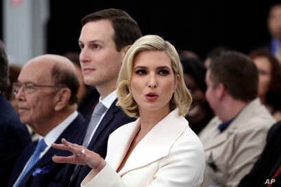 Ivanka Trump, Jared Kushner and Commerce Secretary Wilbur Ross listen during an event with President Donald Trump at the Louis…