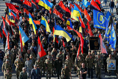 Activists and supporters of Ukraine's nationalist movements take part in a rally against the approval of the so-called…