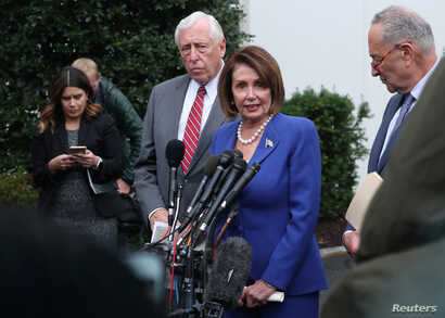 U.S. House Speaker Nancy Pelosi (D-CA) walks out with Senate Minority Leader Chuck Schumer (D-NY) and House Majority Leader Steny Hoyer (D-MD) to speak with reporters after meeting with President Trump at the White House in Washington, Oct. 16, 2019.