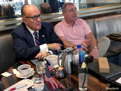 FILE PHOTO: U.S. President Trump's personal lawyer Rudy Giuliani has coffee with Ukrainian-American businessman Lev Parnas at…