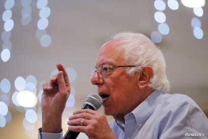 FILE PHOTO: Democratic 2020 U.S. presidential candidate and U.S. Senator Bernie Sanders (I-VT) speaks at a campaign stop in…