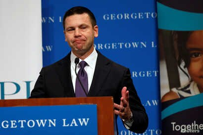 Acting Department of Homeland Security (DHS) Secretary Kevin McAleenan reacts while protesters interrupt his remarks at the Migration Policy Institute annual Immigration Law and Policy Conference in Washington, Oct. 7, 2019.