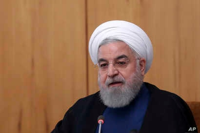 In this photo released by the official website of the office of the Iranian Presidency, President Hassan Rouhani speaks in a cabinet meeting in Tehran, Oct. 2, 2019.