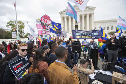 LGBT supporters gather in front of the U.S. Supreme Court, in Washington, Oct. 8, 2019.