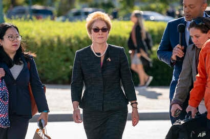 Former U.S. ambassador to Ukraine Marie Yovanovitch, center, arrives on Capitol Hill, Oct. 11, 2019, in Washington.