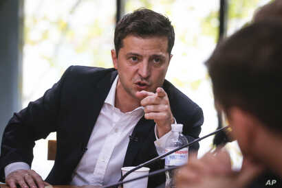 Ukrainian President Volodymyr Zelenskiy speaks during a session with journalists, in Kyiv, Ukraine, Oct. 10, 2019.
