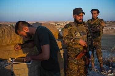 Soldiers loyal to the Kurdish-lead Syrian Democratic forces say they are prepared to fight if or when the US leaves, Aug. 30, 2019 in Al-Bab, Syria. (VOA/Yan Boechat)