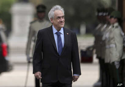 Chilean President Sebastian Pinera arrives to La Moneda presidential palace in Santiago, Chile, Monday, Nov. 4, 2019. Pinera…