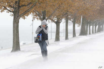 A woman walking  in Chicago weather