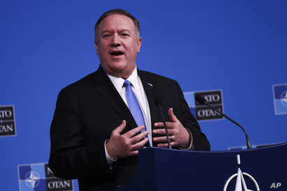 U.S. Secretary of State Mike Pompeo talks to journalists during a news conference during a NATO Foreign Ministers meeting at…