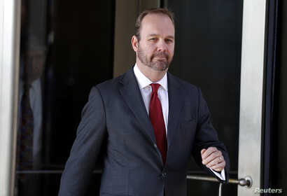 Rick Gates, former campaign aide to U.S. President Donald Trump, departs after a bond hearing at U.S. District Court in…