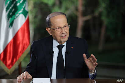AA handout picture provided by the Lebanese photo agency Dalati and Nohra shows Lebanon's President Michel Aoun speaking during a televised interview at the presidential palace in Baabda, east of the capital Beirut, Nov. 12, 2019.