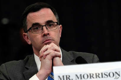 Tim Morrison, a former official at the National Security Council, listens as he testifies before the House Intelligence Committee on Capitol Hill in Washington, Nov. 19, 2019, during an impeachment hearing.