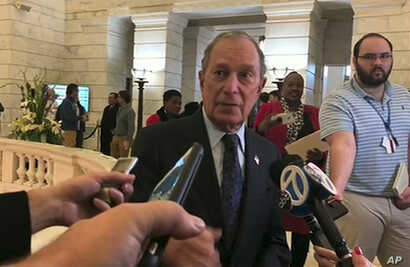 Former New York City Mayor Michael Bloomberg talks to the media after filing paperwork to appear on the ballot in Arkansas' March 3 presidential primary, Nov. 12, 2019 in Little Rock, Ark.
