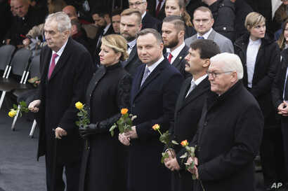From right, the presidents of Germany Frank-Walter Steinmeier, Hungary Janos Ader, Poland Andrzej Duda, Slovakia Zuzana Caputova and of the Czech Republic Milos Zeman, are seen at Berlin Wall ceremony, in Berlin, Germany, Nov. 9, 2019.